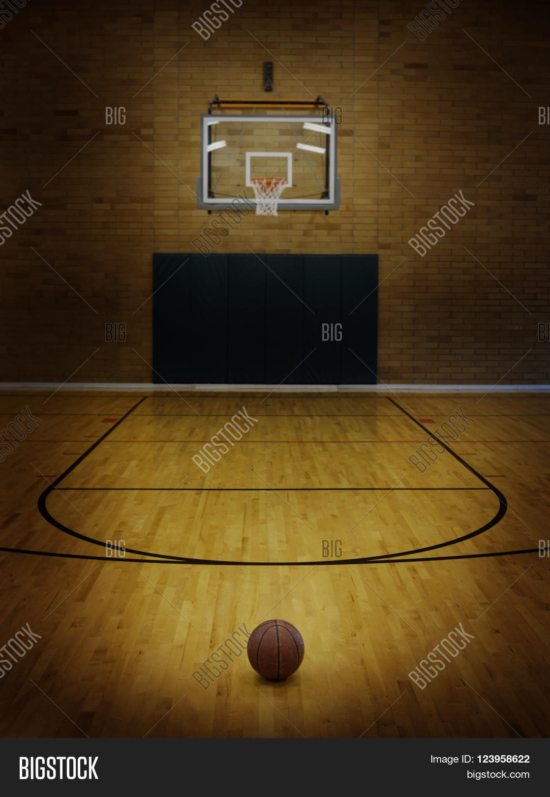 Basketball on floor of empty basketball court stock photo for Custom basketball court cost