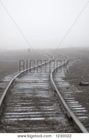 Railroad Tracks Into Fog