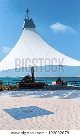 Abu Dhabi, U.A.E. - February 20, 2007: A geometric sunshade in the Corniche seafront.