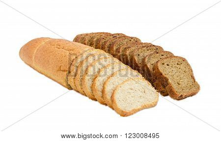 One partly sliced long loaf of wheat bread with bran and sliced brown bread with whole grain on a light background