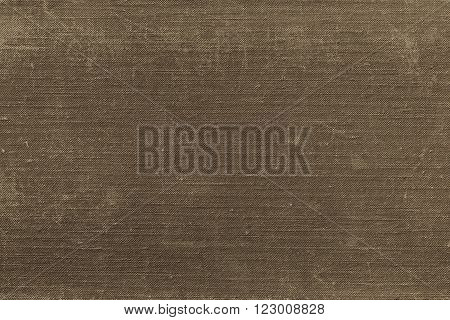 texture of rough old material from cotton or from a sackcloth for a textile background or for wallpaper of sepia color with attritions