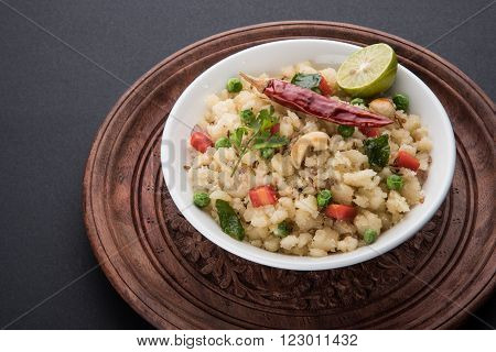 Rava Upma - Popular south Indian breakfast with semolina and vegetables, selective focus, Upma or upama is a South Indian breakfast, cooked from dry roasted semolina. seasonings of vegetables