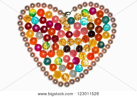Colored glass beads on a white background.