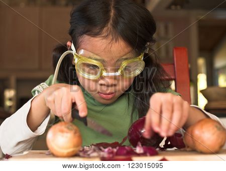 Young Girl Onion peeling technique with diving glasses  diving glass