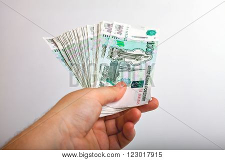 Bundle of bank notes Russia dignity thousand rubles in his hand
