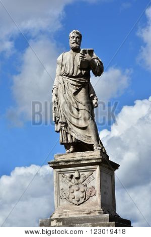Marble statue of Saint Peter patron of Rome at the entrance of Sant'Angelo monumental bridge created by sculptor Lorenzetto in the 16th century