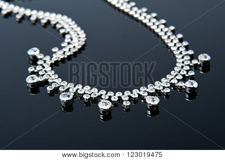 love silver jewelry necklace on black background.