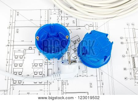 Architecture plan and rolls of blueprints with plug and blue plastic covers. Building concept