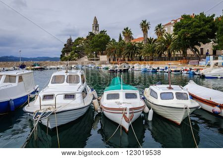 Harbor on Lopud Island with the Franciscan monastery on the backgroung, Croatia