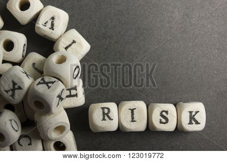 Wood Blocks with the text Risk. Wooden Abc.