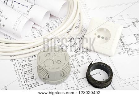 Architecture plan and rolls of blueprints with plug and grey plastic cover. Building concept