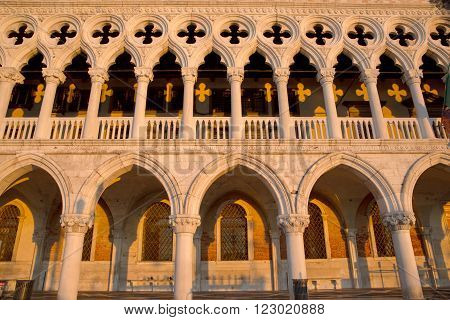 Complete view of Dodge Palace details and yellow shadows on facade, Venice Italy