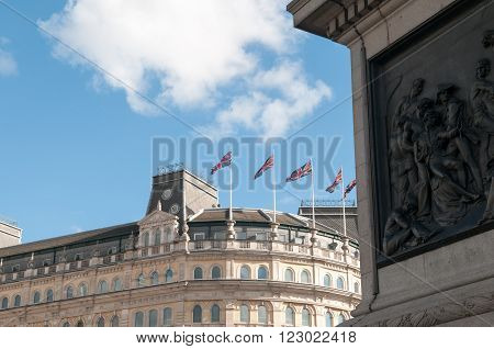 Rooftop view of buildings with flags in central London