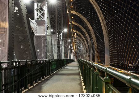 Brisbane Story Bridge walkway and suicide mesh wall prevention barriers by night.
