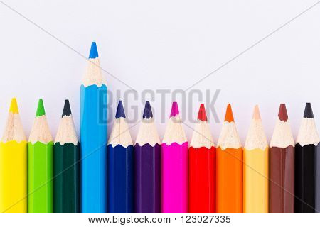 Colorful crayons arranged on a white background.