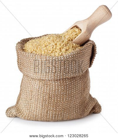 Bulgur or couscous in burlap bag with wooden scoop isolated on white background