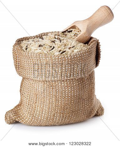 wild brown rice in bag with wooden scoop isolated on white background