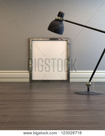 Empty picture frame illuminated by an anglepoise lamp standing on a wooden floor leaning against a grey wall. 3d Rendering.