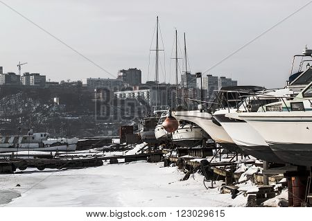 yacht in the winter season on the background of the city Vladivostok