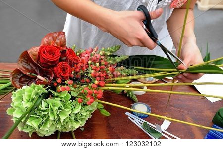 People finishing beautiful and rich bouquet on the competition for florists in Sofia, Bulgaria Aprl 30, 2013