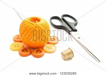 Yellow Plastic Buttons, Thimble, Scissors And Thread