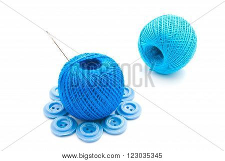Needle, Buttons And Thread On White