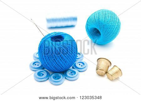 Needle, Blue Buttons, Thimbles And Thread