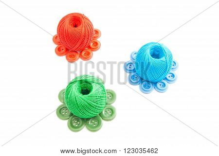 Different Spools Of Thread And Buttons
