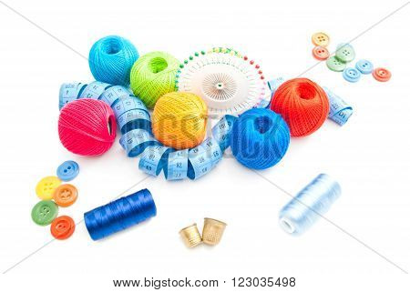 thimbles and other items for needlework on white background