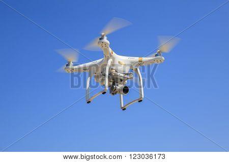 Bangkok Thailand - March 13: Dji Phantom Drone Hover Flying With Camera Recoard Lens Against Blue Sk