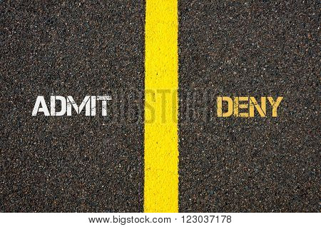 Antonym concept of ADMIT versus DENY written over tarmac road marking yellow paint separating line between words