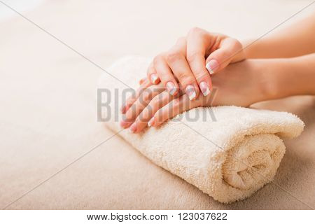 Simple and elegant french manicure in spa salon