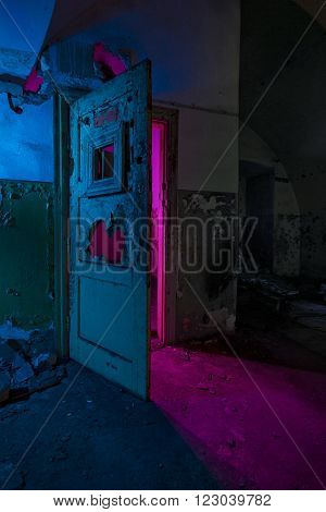 Abstract colorful light painting in abandoned soviet bunker. Pink bright light through broken doors ** Note: Visible grain at 100%, best at smaller sizes