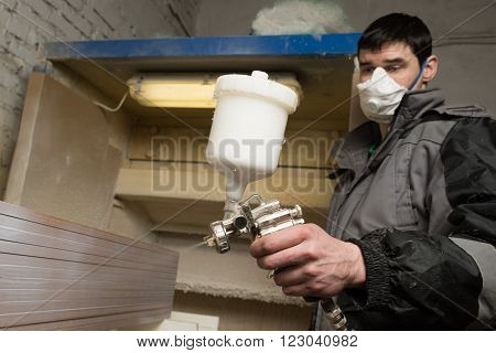 Carpenter Painter Paints The Furniture Board With A Spray Gun On The Production Line Small Wholesale