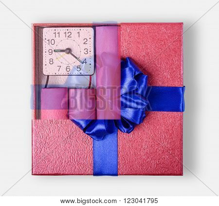 Bomb sticks of dynamite, in a gift box with a blue ribbon with clockwork, terrorism, closeup.