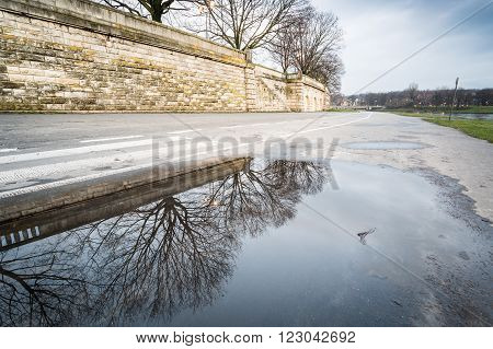 Puddle of rainwater on the Vistula boulevard in Krakow Poland
