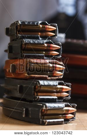 7.62 ammo for machine guns with loaded magazines on table ** Note: Soft Focus at 100%, best at smaller sizes