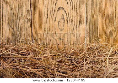 Rural background (straw against the background of a wooden wall, with copy space for your text), retro style