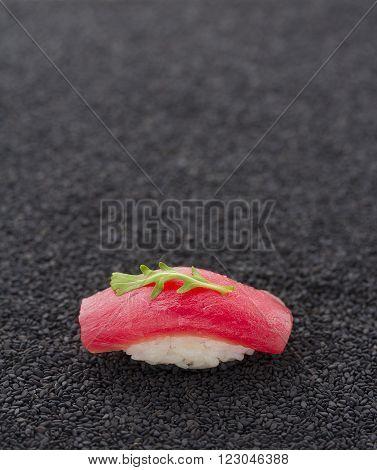 Tuna Sushi Nigiri On Black Sesame Background