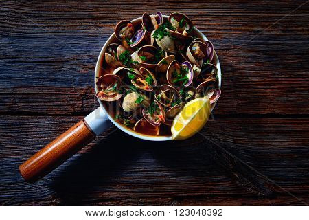 Clams tapa in ceramic pan tapas from Spain seafood