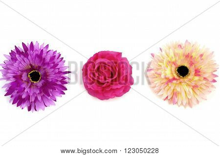 Floristics - droped artificial flowers on white background