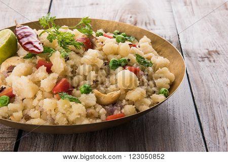 Rava Upma - Popular south Indian breakfast wiih semolina and vegetables, selective focus, Upma or upama is a South Indian breakfast, cooked from dry roasted semolina.
