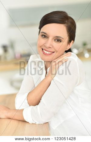 Portrait of attractive 40-year-old woman at home