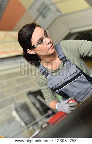 Metalworker woman in workshop