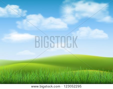 Nature landscape with sky hills and grass on foreground.