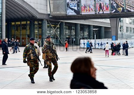 BRUSSELS BELGIUM - MARCH 16: Belgian soldiers on patrol in European Parliament zone due to a raised level of a possible terror attack on March 16 2016 in Brussels.