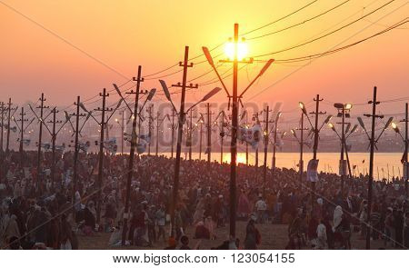 ALLAHABAD, INDIA - FEBRUARY 8, 2013: Thousands of Hindu devotees come to confluence of the Ganges and Yamuna River for holy dip during the festival Kumbh Mela. The world's largest religious gathering