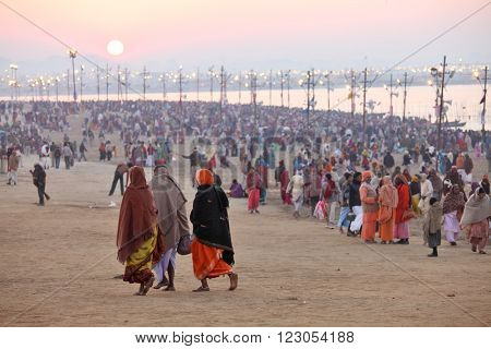 ALLAHABAD, INDIA - FEBRUARY08, 2013: Hindu devotees come to confluence of the Ganges and Yamuna River for ritual holy bathing during the festival Kumbh Mela. The world's largest religious gathering