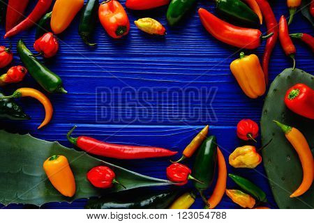 Mexican hot chili peppers colorful mix habanero poblano serrano jalapeno blue background