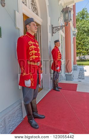 CETINJE, MONTENEGRO - AUGUST 11, 2015: Two Brandenburg guards standing at the front door of the Blue palace old building, residence of President of Montenegro.